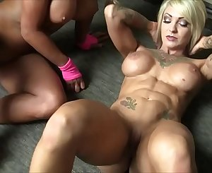 Dani Andrews and Megan Avalon Female Muscle Lesbians
